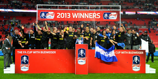 Wigan lift the FA Cup before being relegated